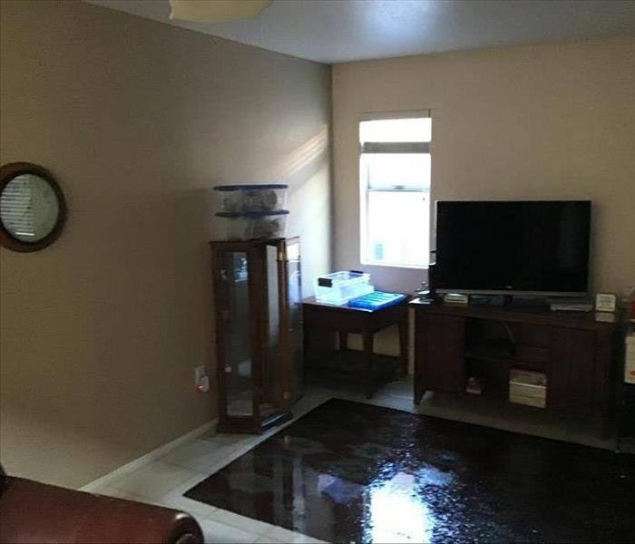 Living room flooded from ceiling water plumbing burst