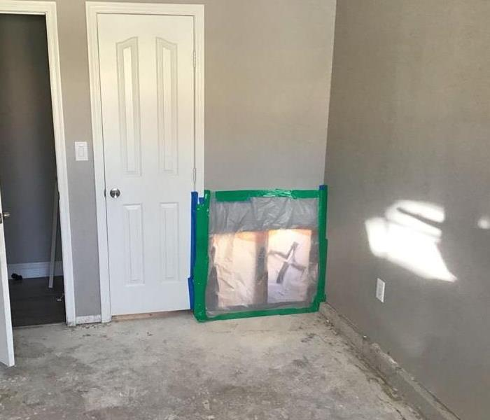 wet carpet and drywall removed
